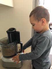 Mason helping in the kitchen